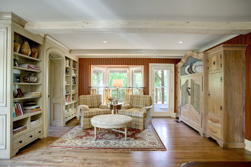 Country Living Room with Standard height, can lights, Crown molding, Bay window, Exposed beam, Built-in bookshelf