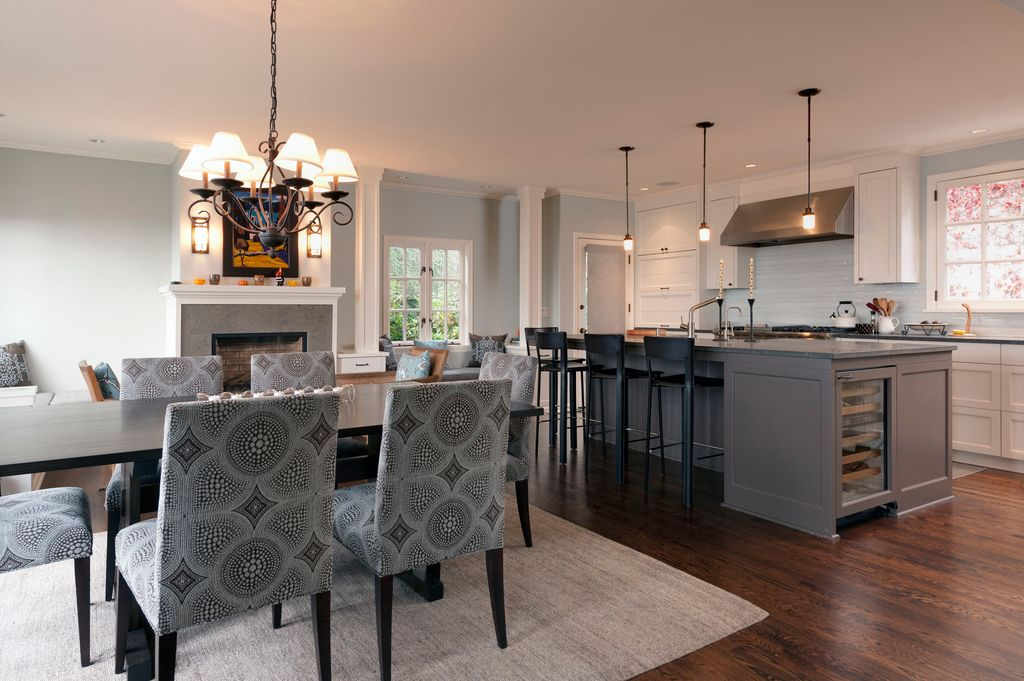 Contemporary Great Room with Wall sconce, Chandelier, Casement, Cement fireplace, Standard height, Fireplace, Pendant light