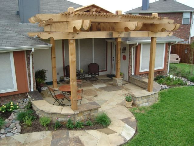 Traditional Patio with exterior stone floors, Pathway, specialty window, French doors, Trellis, Fence