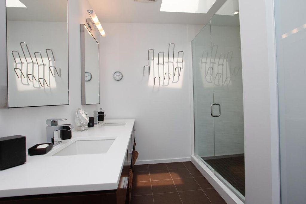 Contemporary 3/4 Bathroom with stone tile floors, frameless showerdoor, can lights, European Cabinets, Shower, Flush