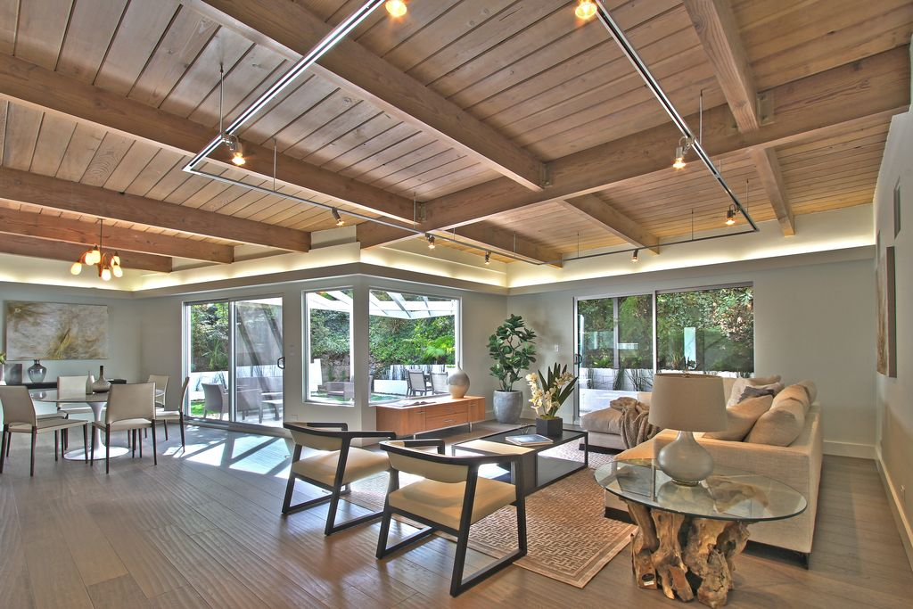 Contemporary Great Room with Standard height, picture window, Hardwood floors, flush light, Exposed beam, Chandelier