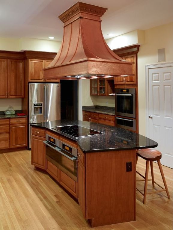 Craftsman Kitchen with Glass panel, Flush, Complex granite counters, six panel door, Breakfast bar, electric cooktop