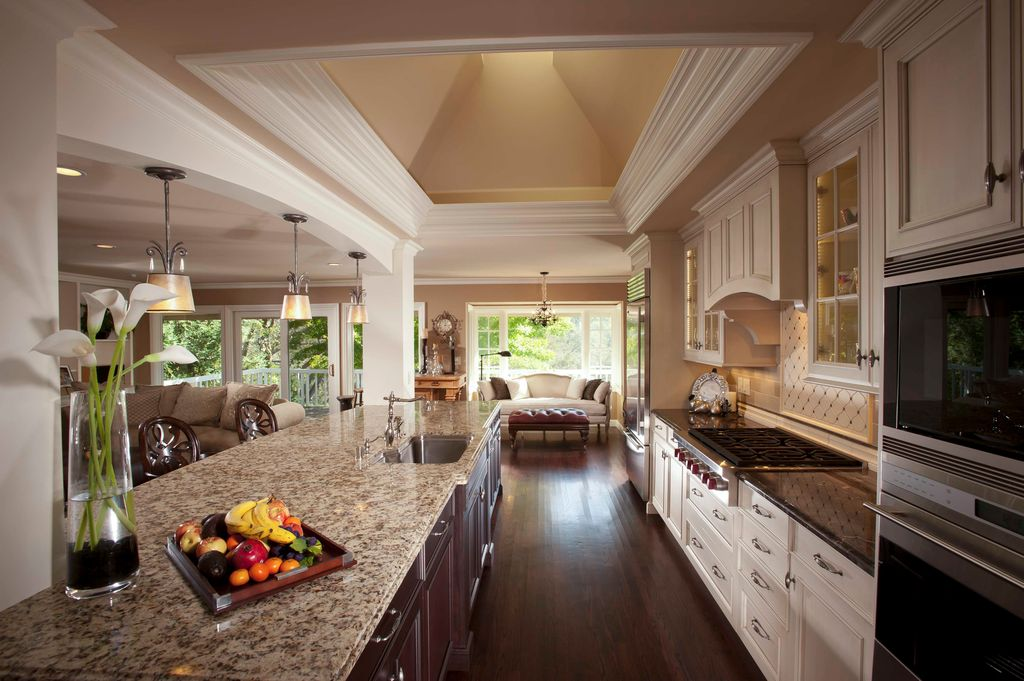 Traditional Kitchen with Breakfast bar, Galley, wall oven, Paint 1, Crown molding, Skylight, Kendra mini pendant by quoizel