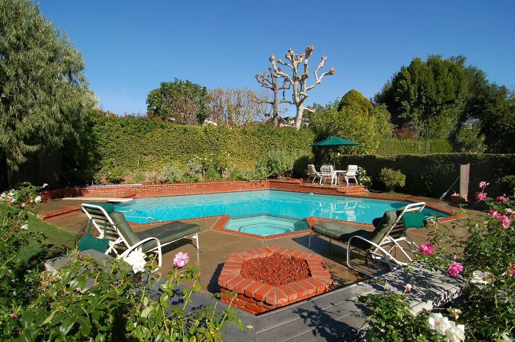 Traditional Swimming Pool with Pool with hot tub, exterior concrete tile floors, exterior tile floors, Fire pit, Fence