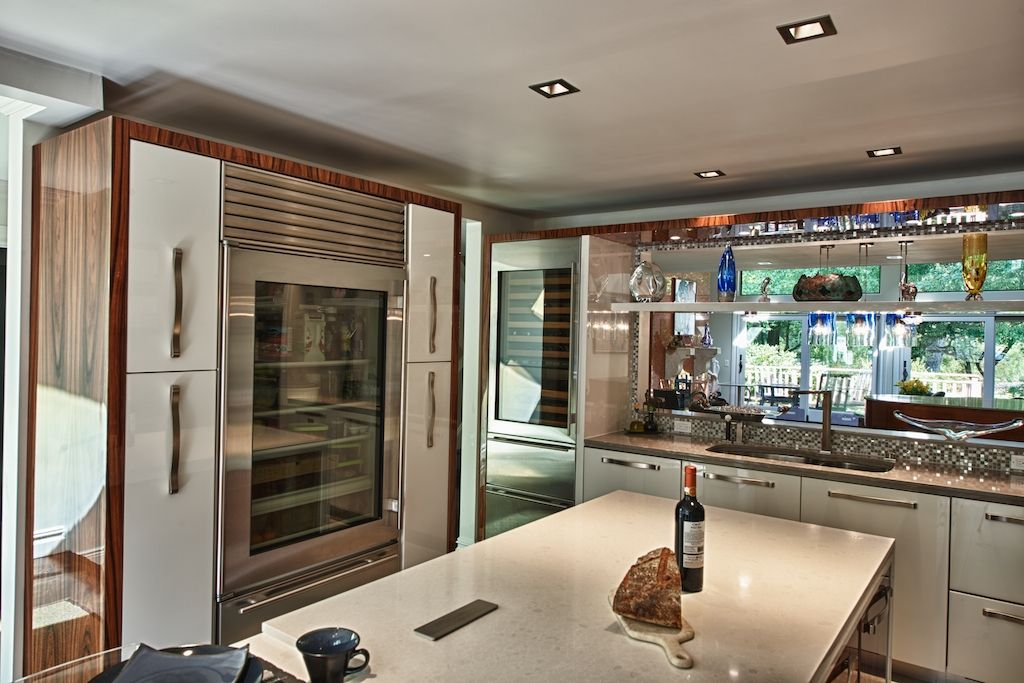 Contemporary Kitchen with European Cabinets, Wine refrigerator, Quartz counters, Casement, partial backsplash, L-shaped
