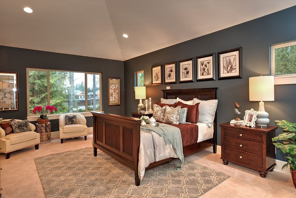 Traditional Master Bedroom with High ceiling, Carpet, can lights, Casement, picture window