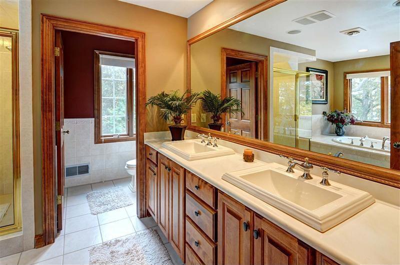 Craftsman Master Bathroom with Inset cabinets, Drop-in sink, six panel door, Shower, can lights, full backsplash, Casement