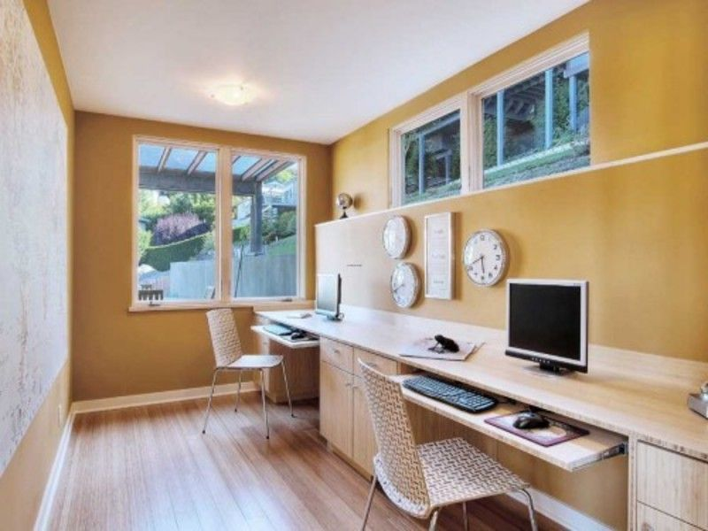 Contemporary Home Office with specialty window, Casement, Built-in bookshelf, Standard height, Laminate floors, flush light