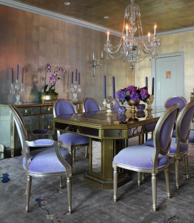 Traditional Dining Room with Contrasting interior trim, Empire style upholstered dining chairs, Chandelier, Crown molding