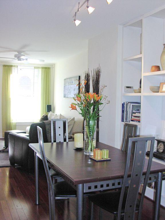 Contemporary Dining Room with Built-in bookshelf, Hardwood floors, flush light, Standard height