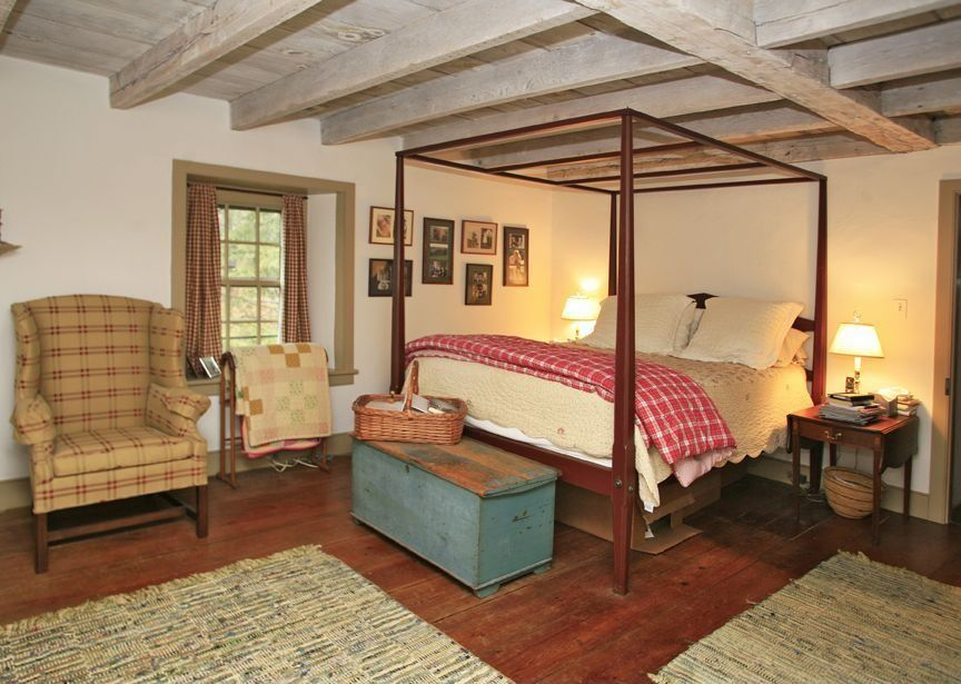 Country Master Bedroom with Standard height, Exposed beam, Hardwood floors, double-hung window