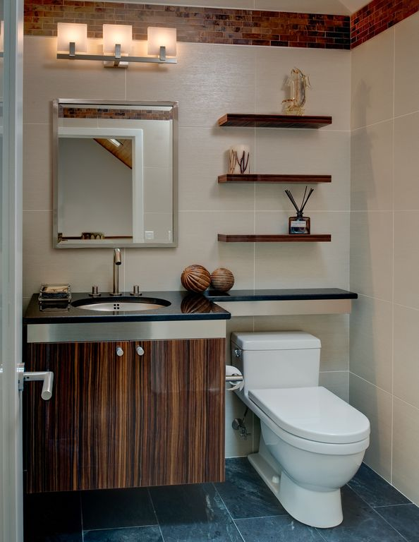 Contemporary Powder Room with Simple granite counters, Undermount sink, stone tile floors, Zebrawood veneer, High ceiling
