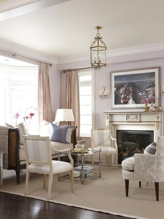 Traditional Living Room with Box ceiling, metal fireplace, Bay window, Pendant light, Hardwood floors, Crown molding
