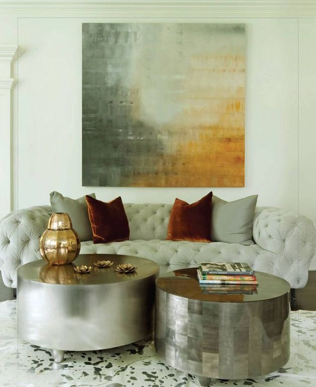 Eclectic Living Room with Crown molding, Standard height, Baxter - tufted sofa, Hardwood floors