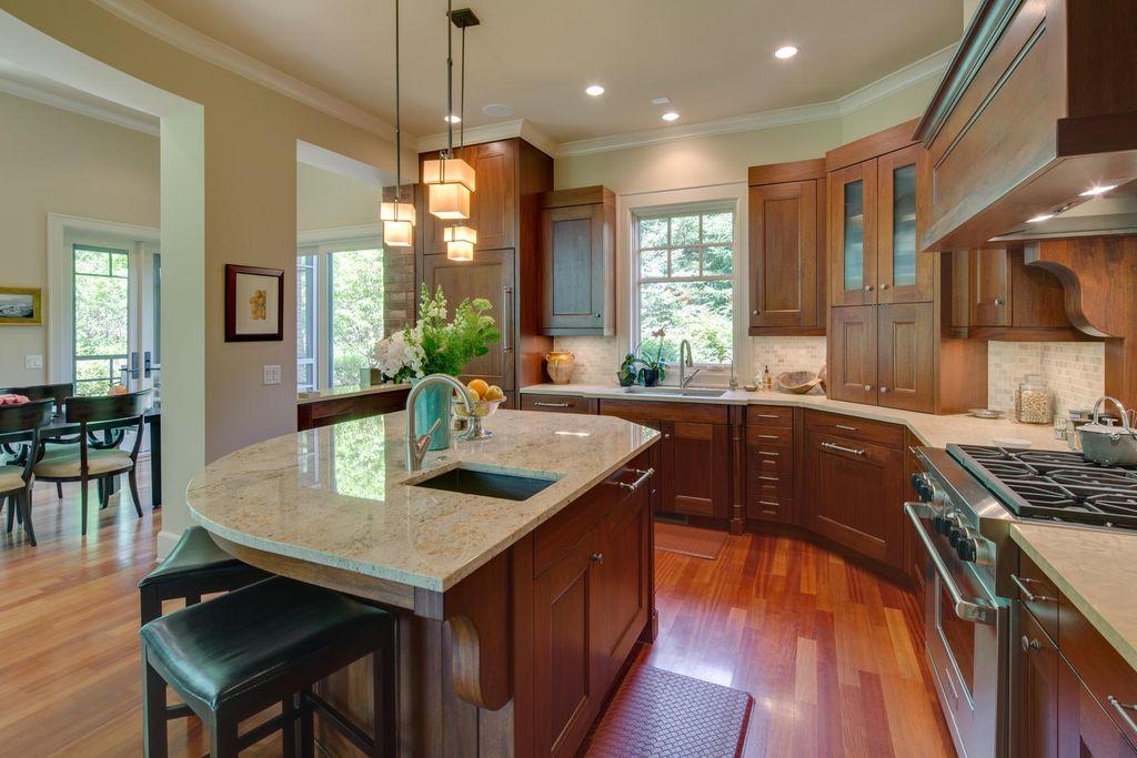 Craftsman Kitchen with Casement, Undermount sink, Kitchen island, Flat panel cabinets, Limestone Tile, Stone Tile, L-shaped