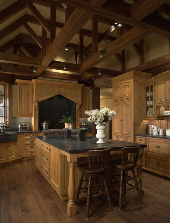 Traditional Kitchen with Knotty pine cabinet door, Marble countertop, Spindle leg bar stool, Exposed beam ceiling