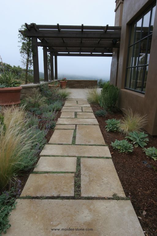 Mediterranean Landscape/Yard with Casement, Trellis, exterior tile floors, Pathway
