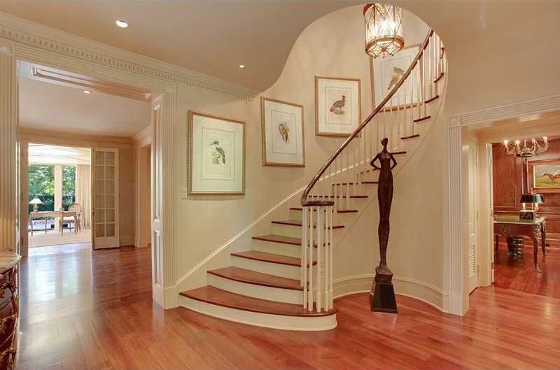 Traditional Staircase with Pendant light, curved staircase, High ceiling, can lights, Hardwood floors