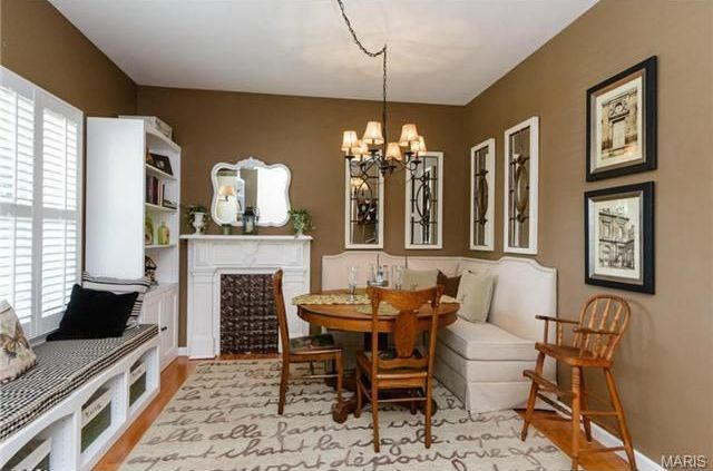 Traditional Dining Room with Standard height, Window seat, Cement fireplace, Chandelier, Built-in bookshelf, Hardwood floors