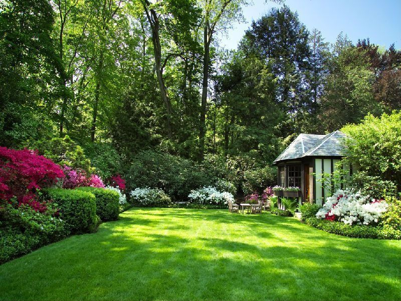 Traditional Landscape/Yard with picture window, Gazebo, Raised beds