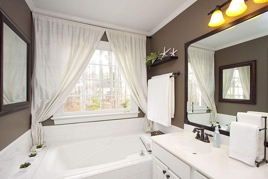 Cottage Full Bathroom with Simple Marble, Raised panel, Simple marble counters, Portfolio lyndsey vanity light, Crown molding