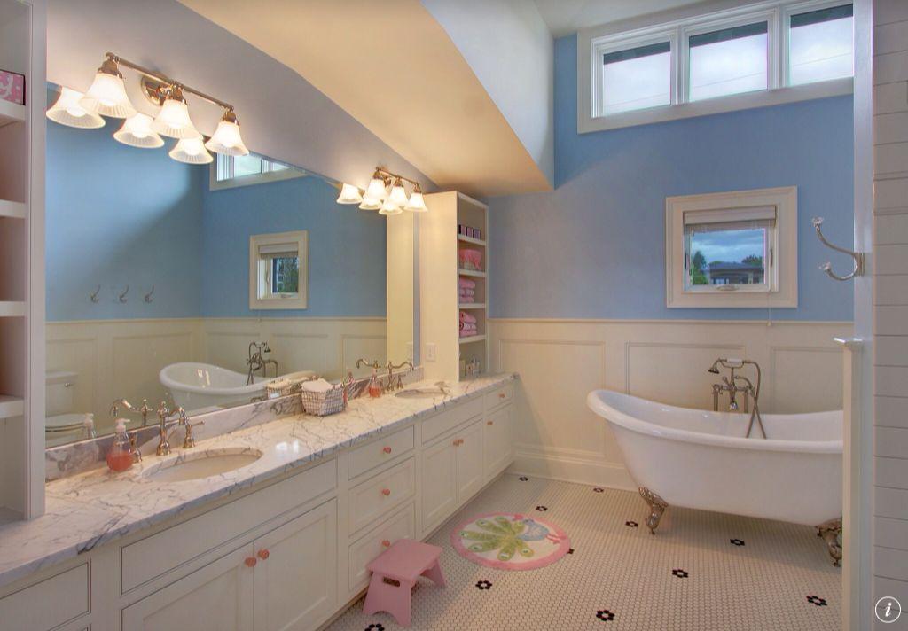 Traditional Kids Bathroom with penny tile floors, linen and towel storage cabinet, Flat panel cabinets, full backsplash