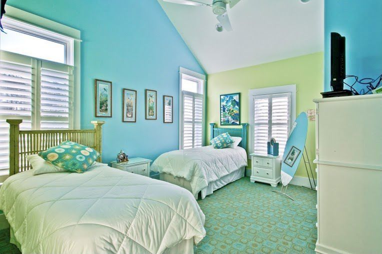 Cottage Guest Bedroom with High ceiling, picture window, Built-in bookshelf, Carpet, can lights, Ceiling fan