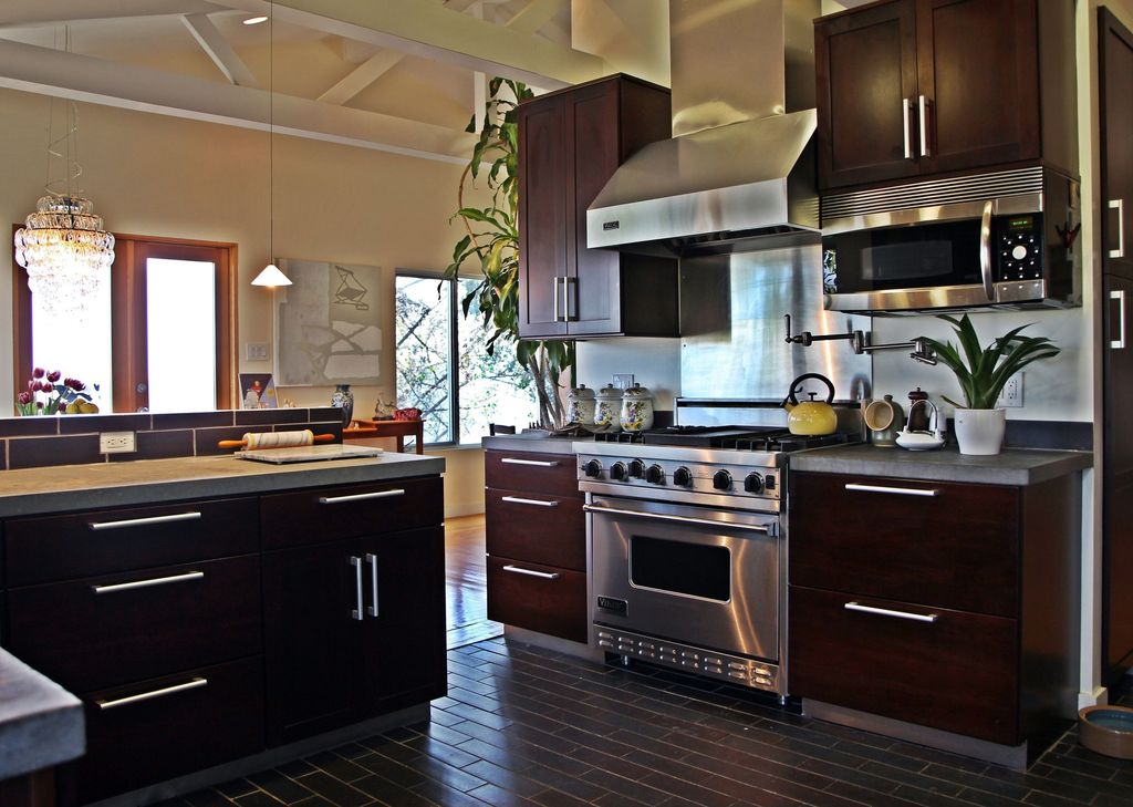 Contemporary Kitchen with Wall Hood, Pendant light, Hardwood floors, built-in microwave, European Cabinets, gas range, Flush