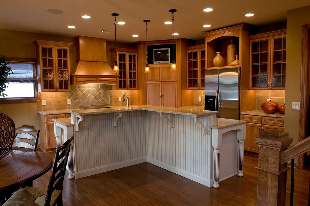 Traditional Kitchen with Limestone Tile, Flat panel cabinets, Framed Partial Panel, Breakfast nook, Pendant light, can lights