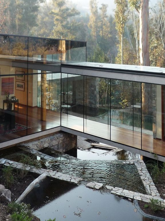 Modern Exterior of Home with Stacked stone wall, Flat roof, Bridge, Hardwood floors, Coihue timber beams