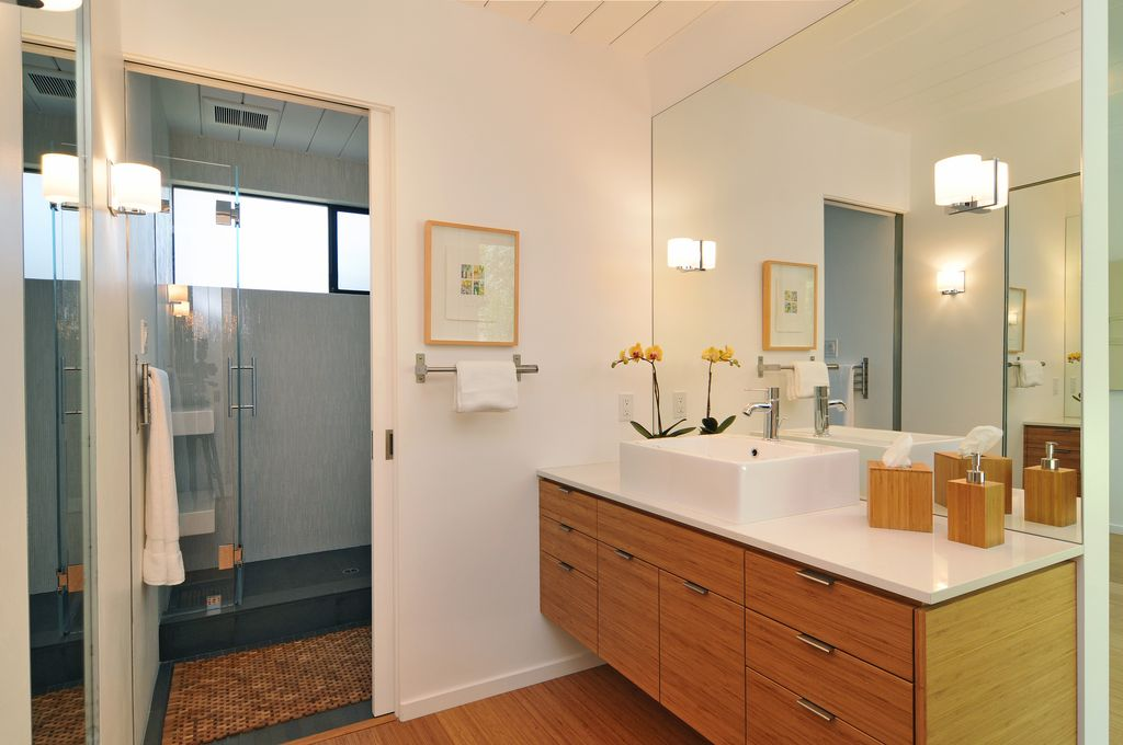 Contemporary 3/4 Bathroom with Corian counters, three quarter bath, wall-mounted above mirror bathroom light, Shower, Flush