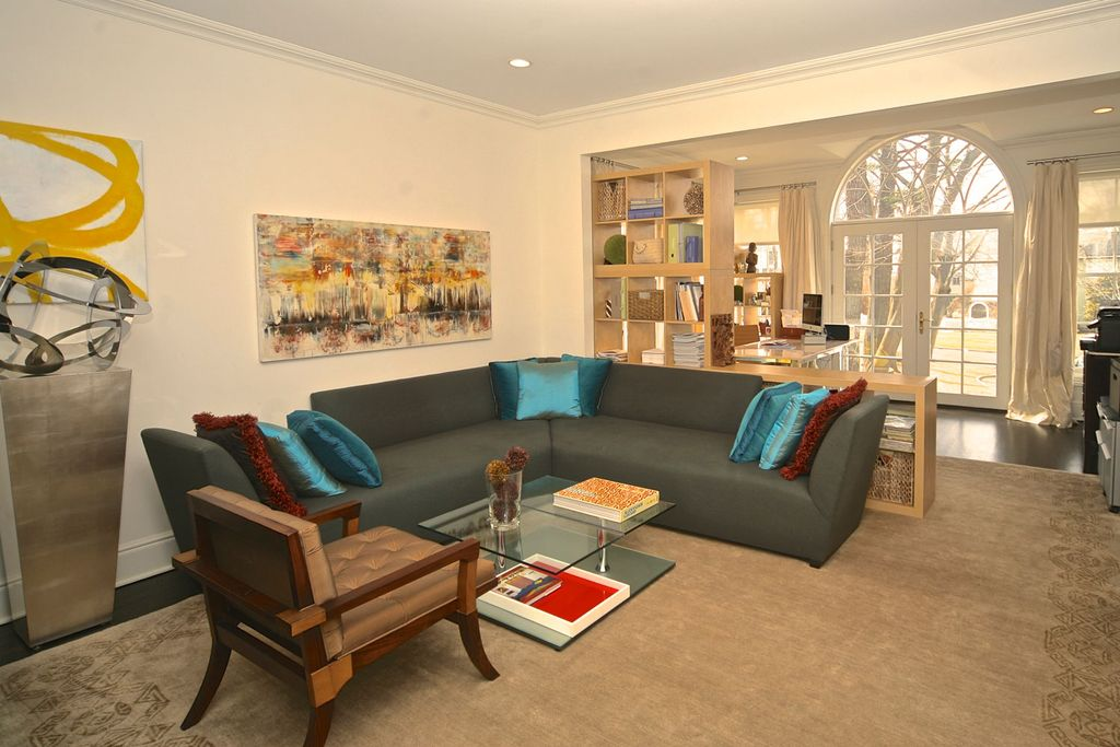 Contemporary Living Room with can lights, Standard height, Concrete floors, Crown molding