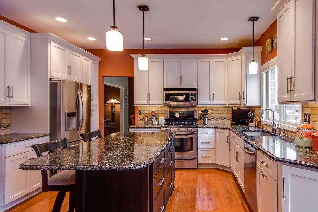 Traditional Kitchen with TUMBLED STONE 3X6 SUBWAY - TUSCANY IVORY, Standard height, gas range, Paint 1, can lights, U-shaped