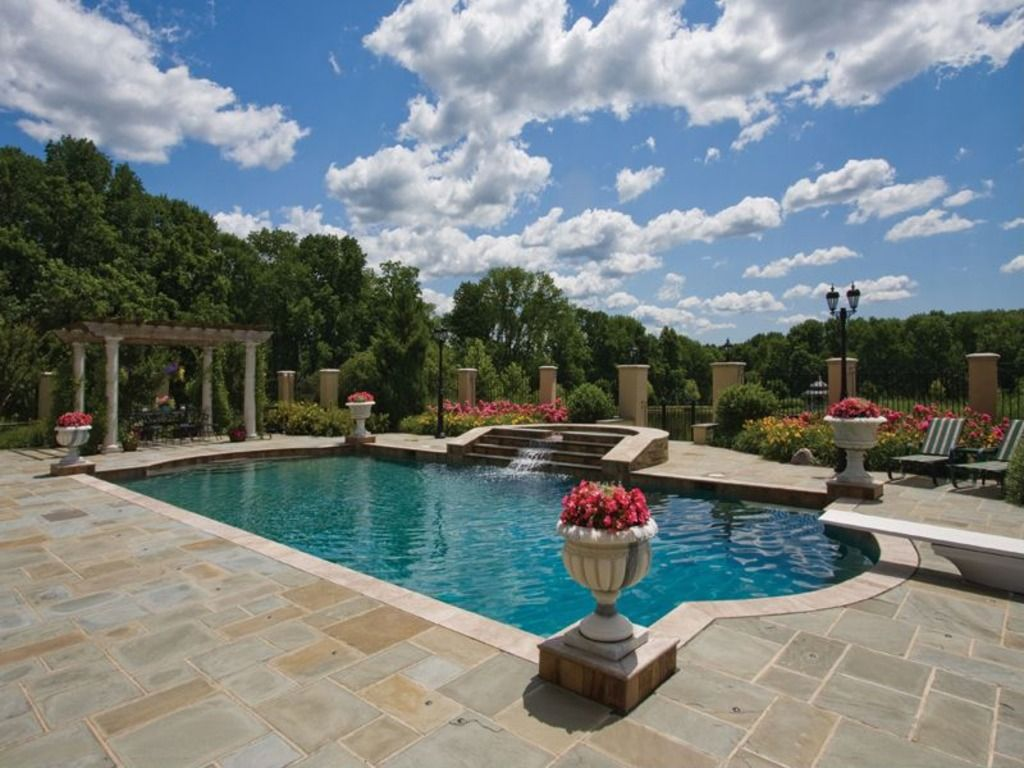 Mediterranean Swimming Pool with exterior stone floors, Fence, Pool with hot tub, Trellis