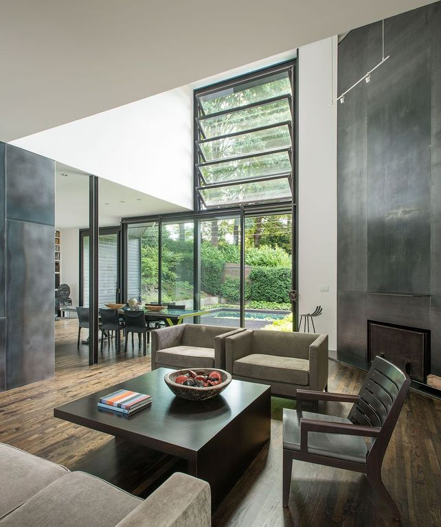 Contemporary Living Room with High ceiling, flush light, sliding glass door, Fireplace, specialty window, Hardwood floors
