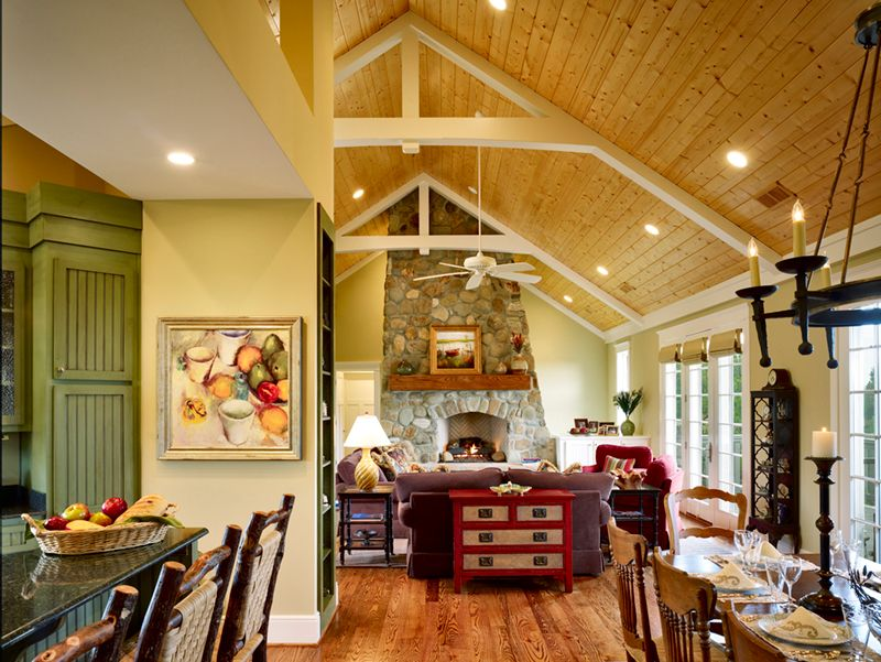 Eclectic Great Room with Ceiling fan, Fireplace, stone fireplace, Hardwood floors, picture window, Chandelier, Exposed beam