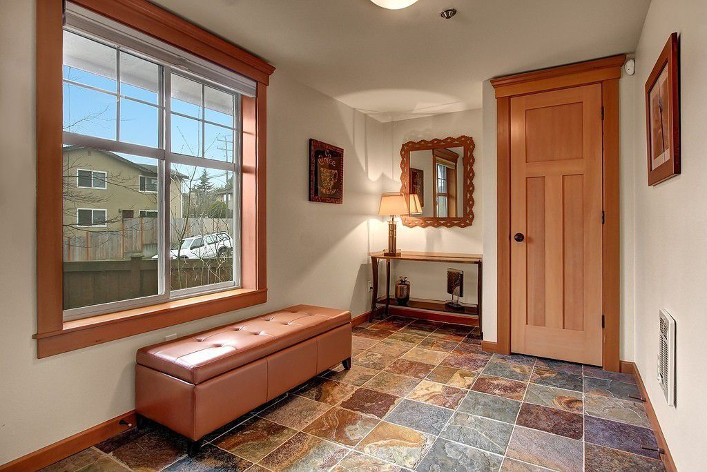 Craftsman Entryway with can lights, Standard height, travertine floors, specialty door, double-hung window