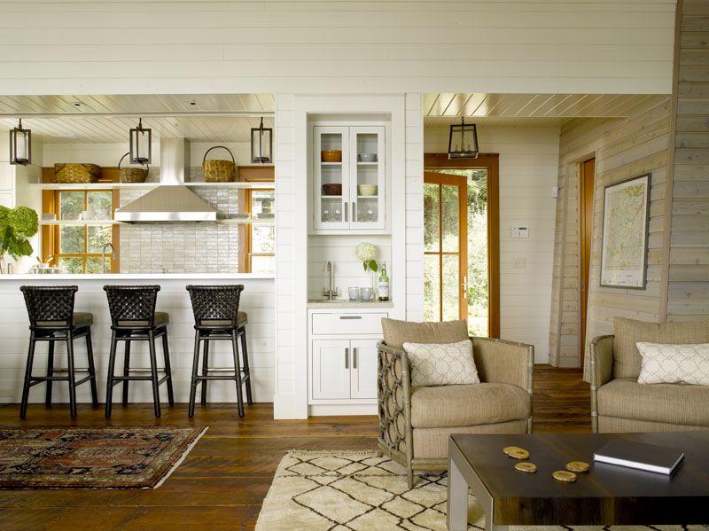 Cottage Great Room with Hardwood floors, Bronze 4-light foyer hanging lantern, High ceiling, Built in wet bar, Pendant light
