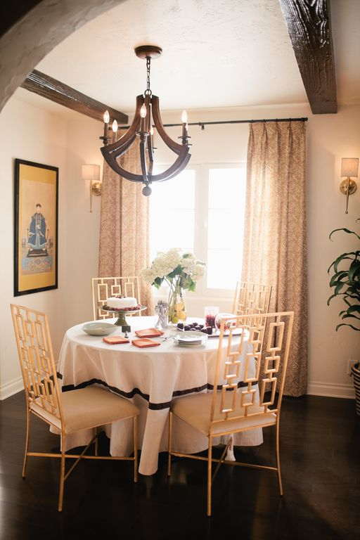 Eclectic Dining Room with Casement, Wall sconce, Hardwood floors, Standard height, Chandelier, Exposed beam