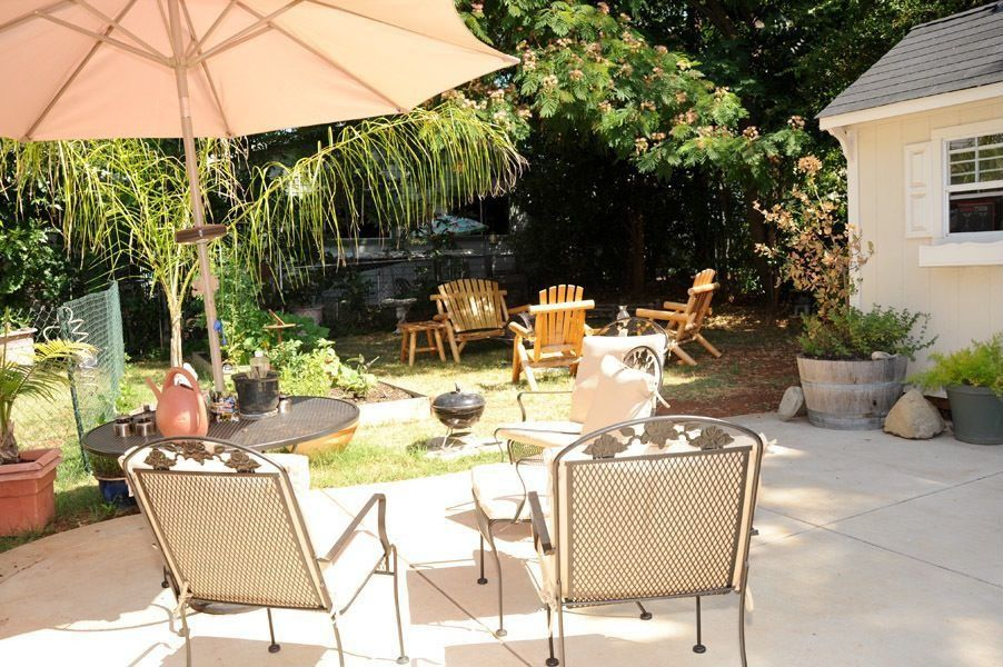 Traditional Patio with exterior tile floors, exterior concrete tile floors, Fence