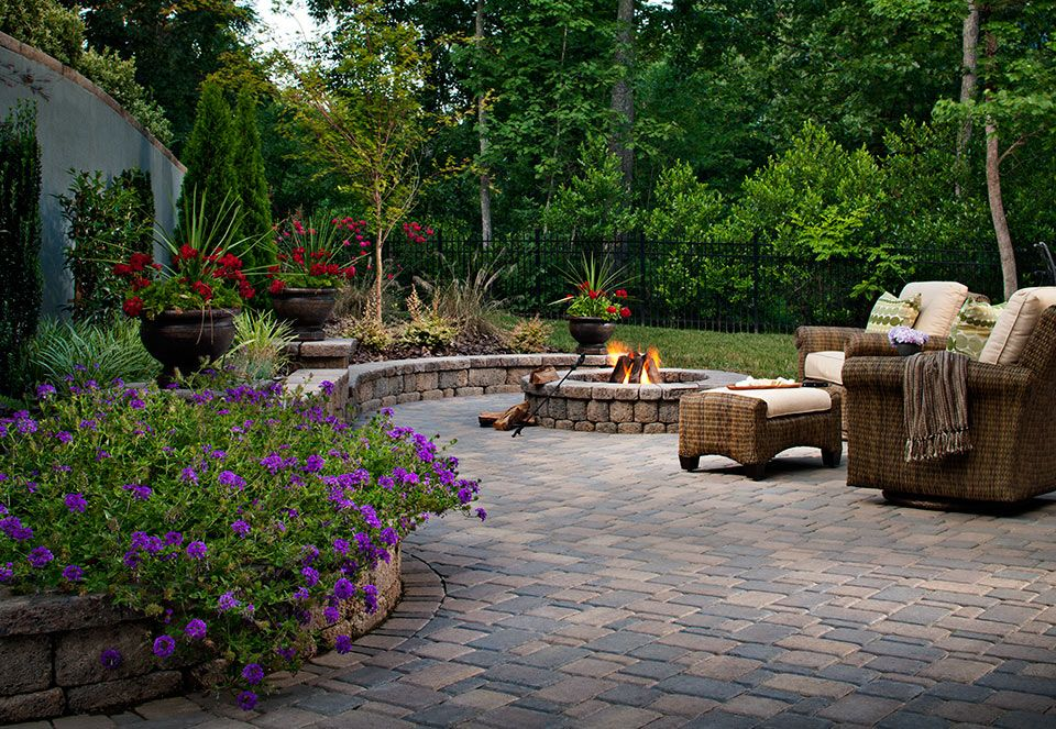 Traditional Patio with exterior stone floors, Raised beds, Fire pit, Fence