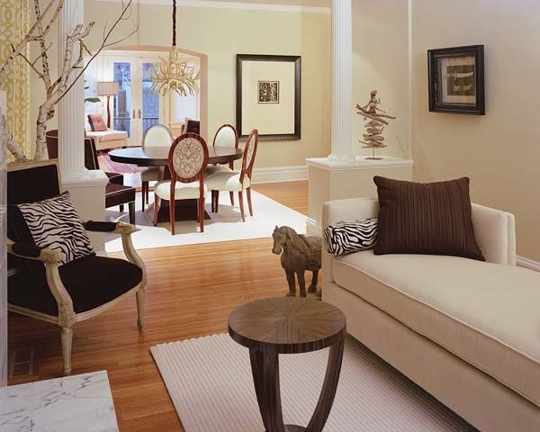 Contemporary Living Room with Columns, Laminate floors, High ceiling, Crown molding