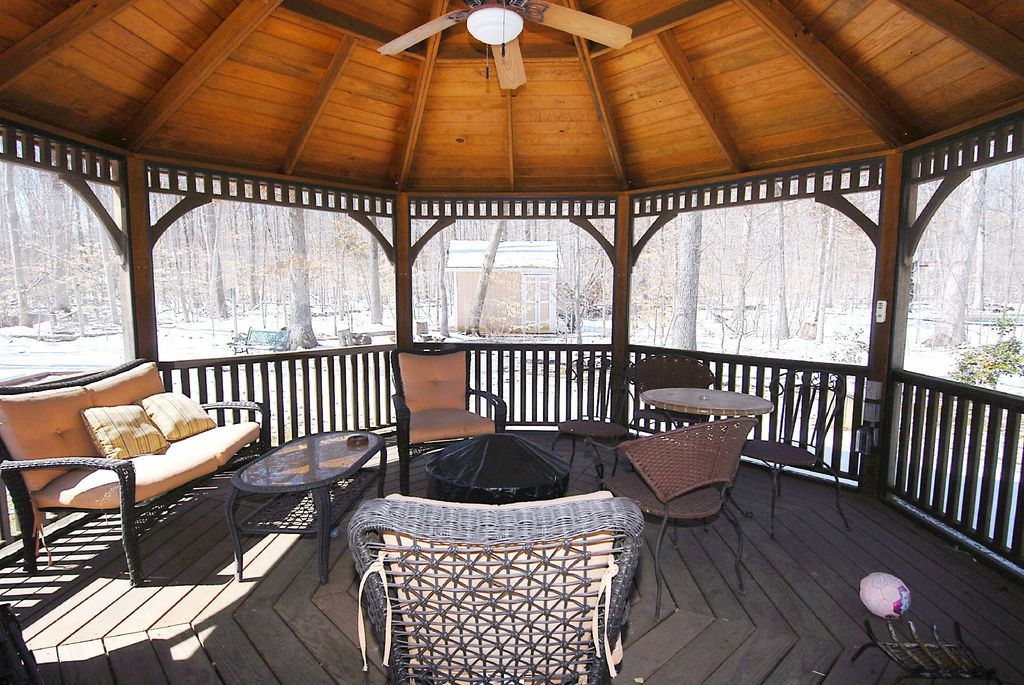 Rustic Porch with Wrap around porch, Gazebo, French doors, Deck Railing
