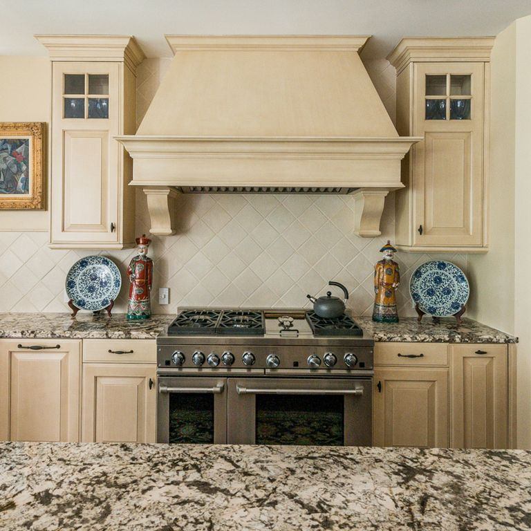 Traditional Kitchen with Custom hood, Standard height, full backsplash, Raised panel, Stone Tile, Limestone Tile, Glass panel