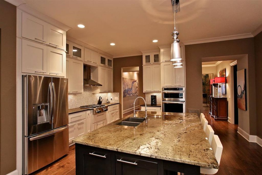 Contemporary Kitchen with full backsplash, Standard height, Flush, Flat panel cabinets, double wall oven, can lights