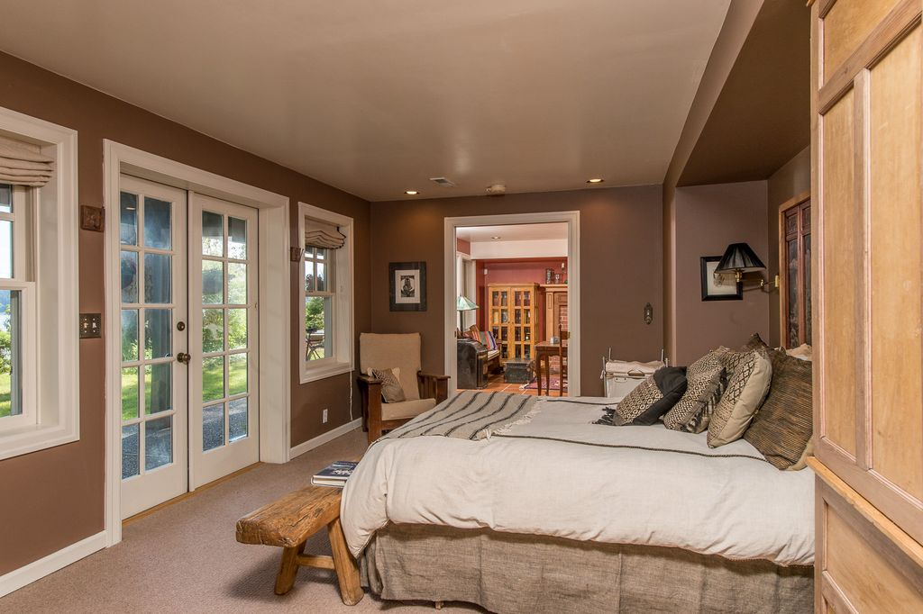traditional master bedroom with carpet in vashon wa