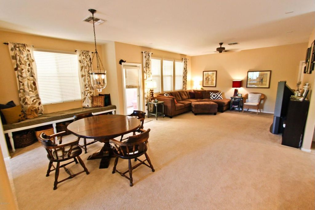 Traditional Great Room with Carpet, can lights, Ceiling fan, Standard height, French doors, Pendant light