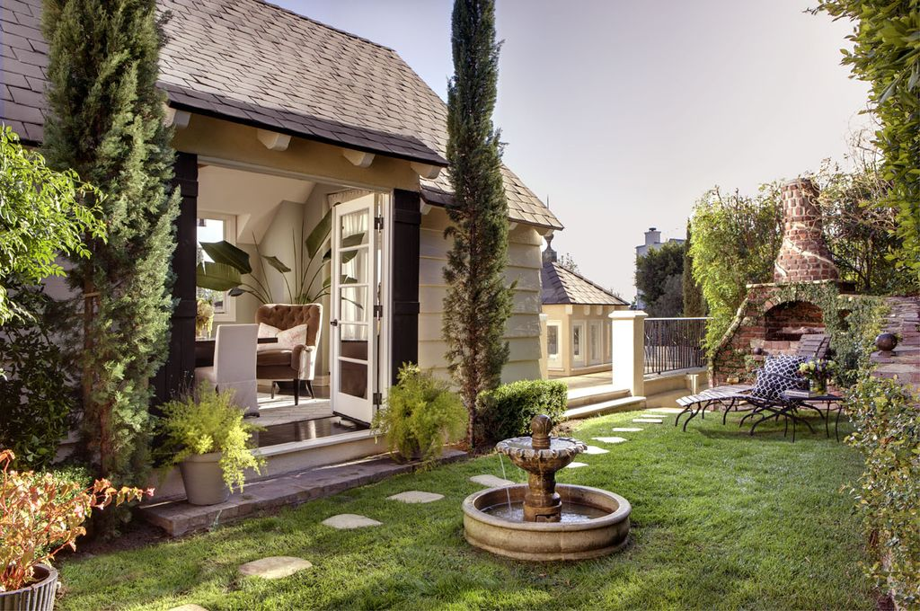 Traditional Landscape/Yard with exterior stone floors, French doors, Fountain, outdoor pizza oven, Fence, Pathway