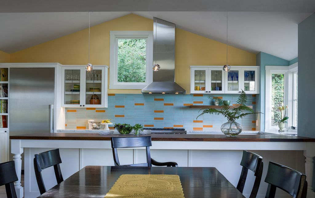 Contemporary Kitchen with Wood counters, electric cooktop, full backsplash, U-shaped, can lights, picture window, Wall Hood