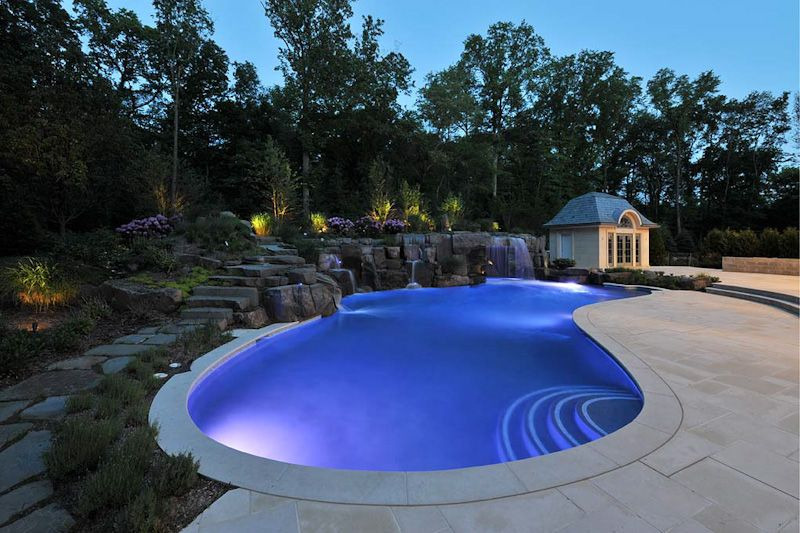 Traditional Swimming Pool with exterior stone floors, Raised beds, Pathway, French doors, Fountain, Gazebo, Arched window